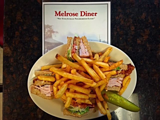a lunch favorite: piled-high turkey club served with crispy french fries