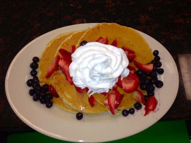 Fresh berry pancakes with whipped cream. Irresistible!