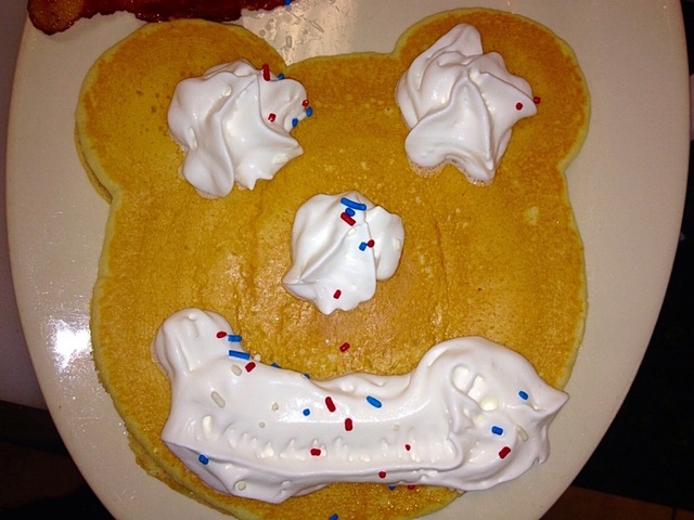 kids funny face pancake with whipped cream and sprinkles. What a delicious treat for your little ones!